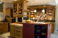 Landers Studio made several of the unique cabinets for the personal kitchen of the owner of sutton design specializing in kitchen design.