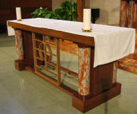 This 700 lb. altar for St. Austin Catholic Church is made with stained white oak and marble and brass from the former communion railing