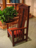 Presiders chair for St. Austin Catholic Church with ergonomic design and construction in stained white oak with a contrasting rosewood cross in back.