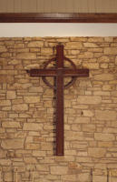 A handcarved walnut cross for an Episcopal church measuring 87-1/2H x 45-3/4W