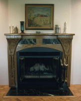 -  Carved white oak mantel with Italian marble combines traditional styling with Art Noveau influenced carvings